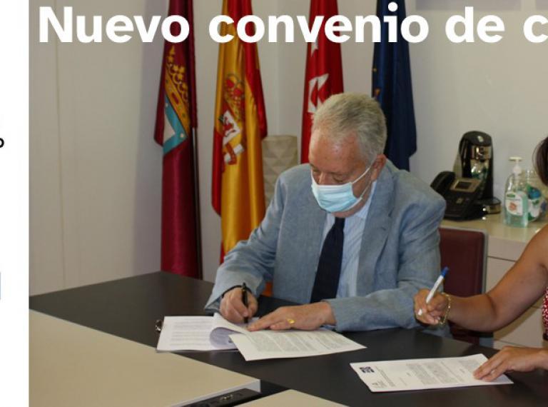 Logos de ASEPAU y Colegio de Aparejadores de Madrid más foto de la firma de los dos presidentes sobre mecha de despacho